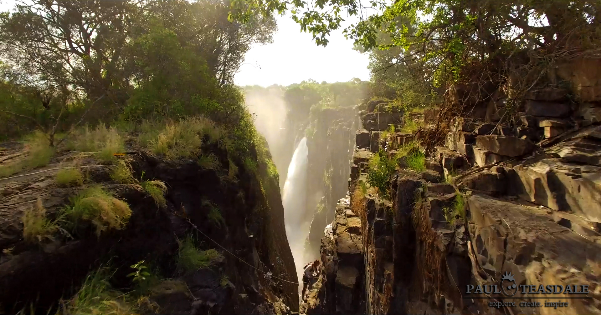 Paul Teasdale descends the crack where the Victoria Falls is cutting back with the Devil's Cataract in the bacground