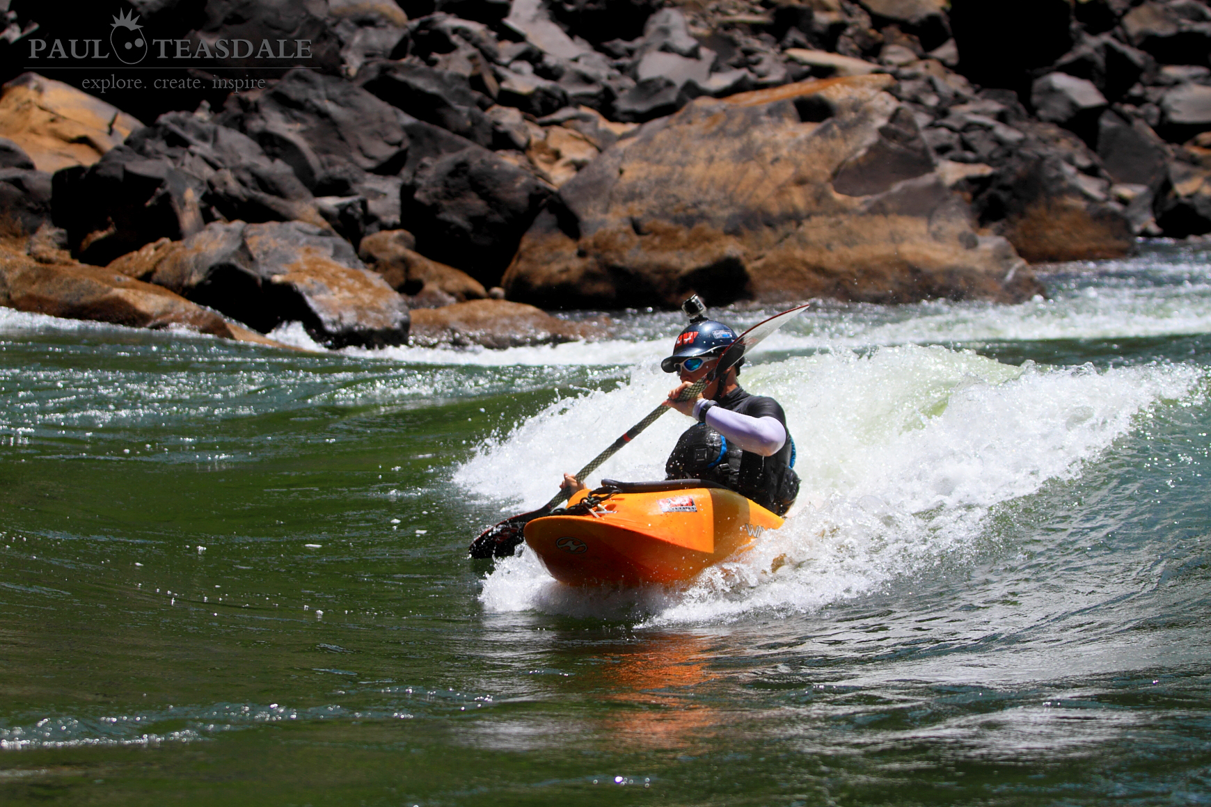 Paul Teasdale surfing a small wave above Rapid 16b on the Zambezi River