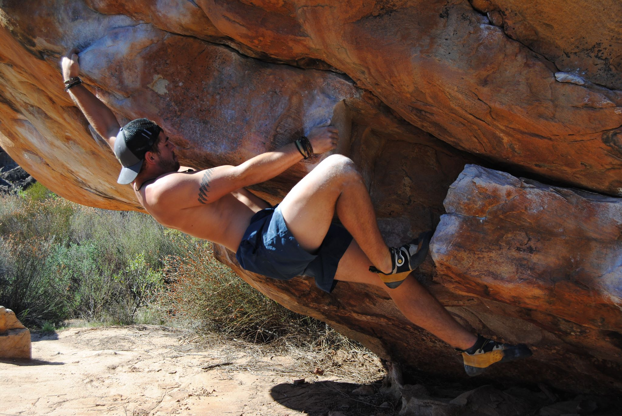 Luke Bax Climbing a nice boulder problem in Rocklands South Africa